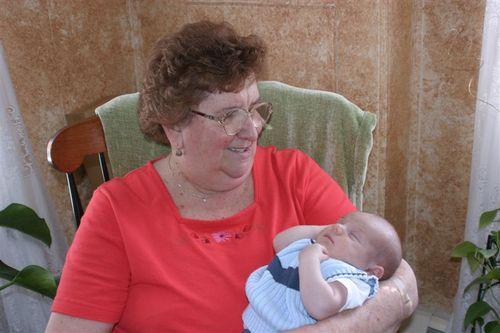 Being held by Great-Grandma Shea